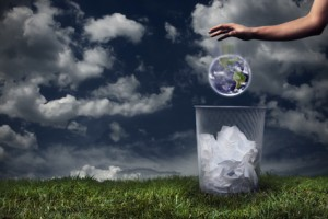 Earth being dropped in the trash | Maling's Missives on the environment being affected by pollution